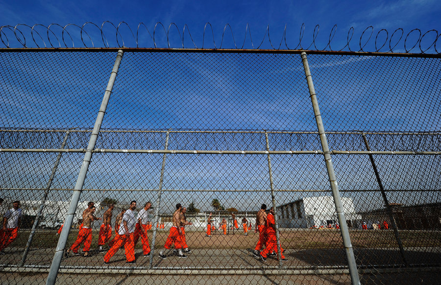 Prison yard prisoners orange jumpsuits