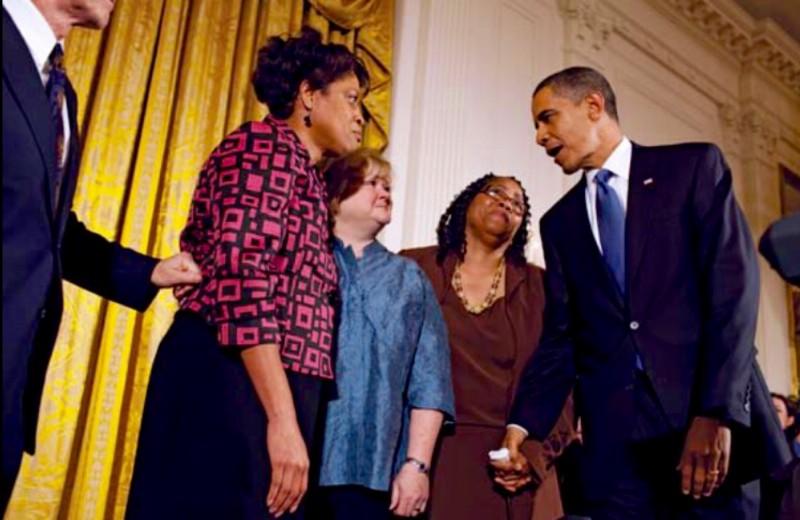 President Obama Shaking Hands Signing Bill